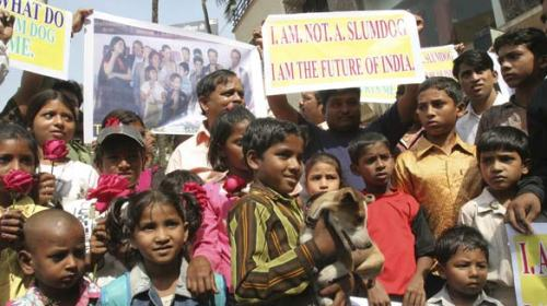 Residents of a Mumbai slum show their displeasure over the name of the hit film Slumdog Millionaire in a protest outside the office the film's co-star, Anil Kapoor.